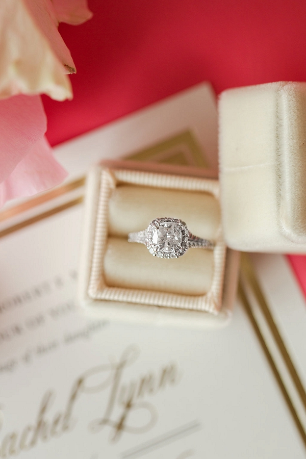 Sparkling solitaire diamond ring with a diamond border