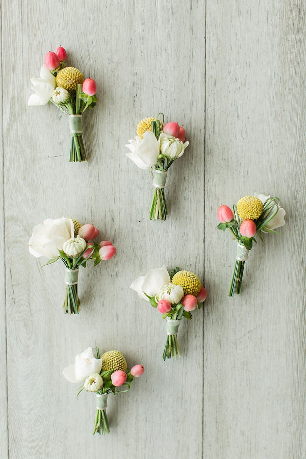Groomsmen boutonnieres with pink red hypericum berries and yellow billy balls