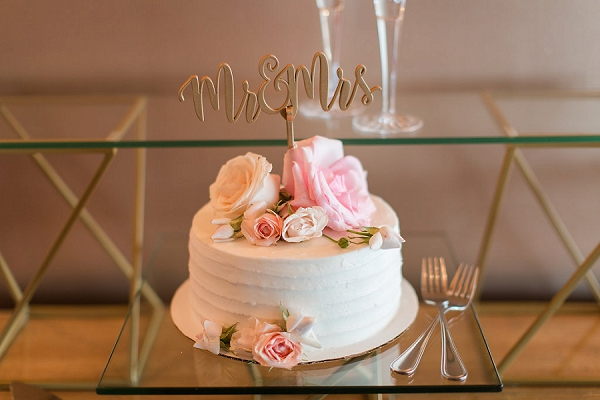 Simple one layer wedding cake with gold Mr and Mrs cake topper