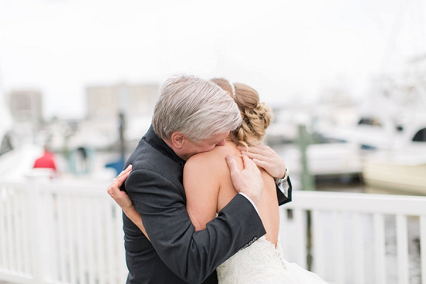 Emotional father and daughter first look on wedding day