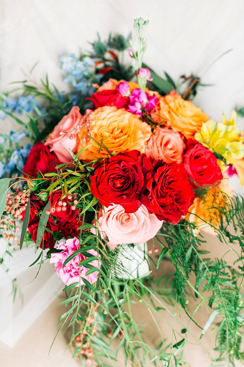 Bright and vibrant wedding bouquet filled with red and yellow roses