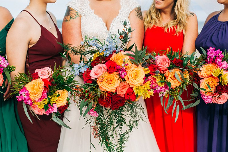 Lush and wild wedding bouquets for a brightly colored beach wedding