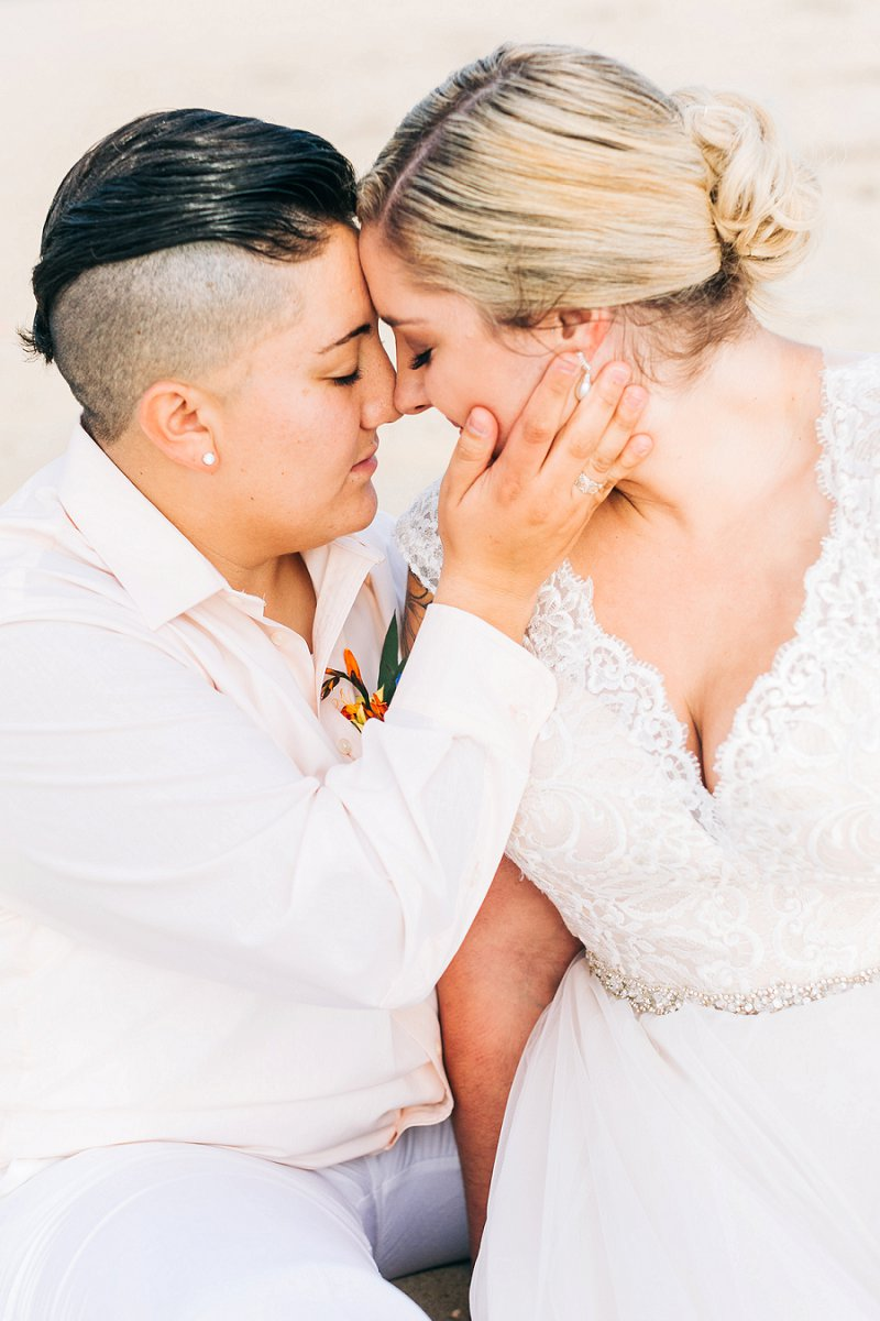 Beautifully colorful beach wedding with two brides in Virginia Beach