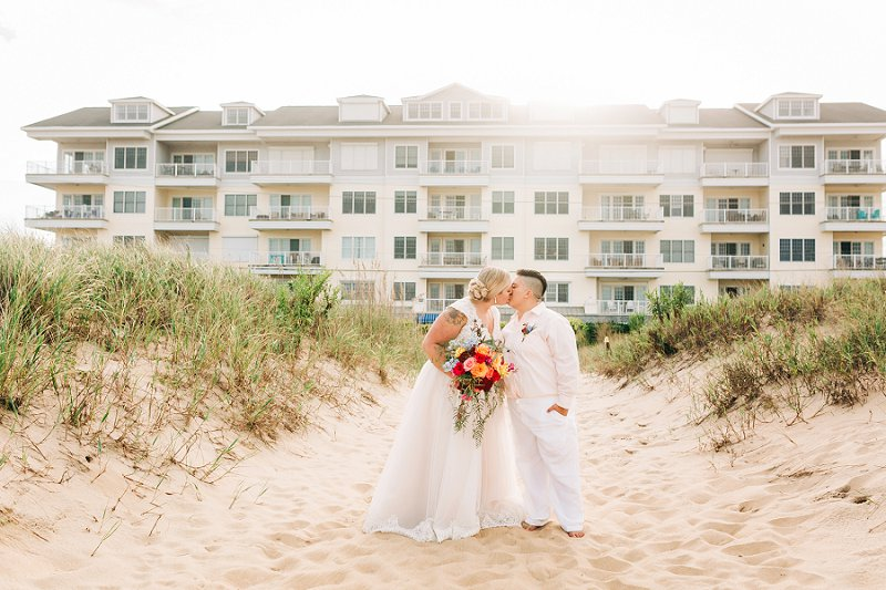 Virginia Beach wedding with two brides and their colorful destination celebration on the sand