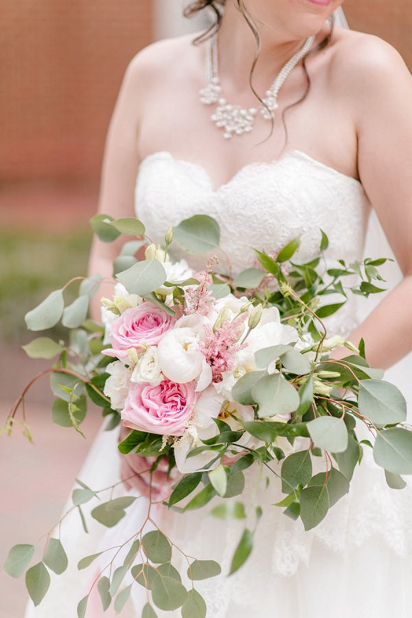 Pink and white bridal bouquet with eucalyptus and peonies