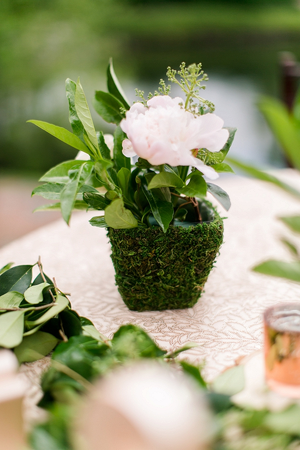 Moss covered centerpieces for garden wedding