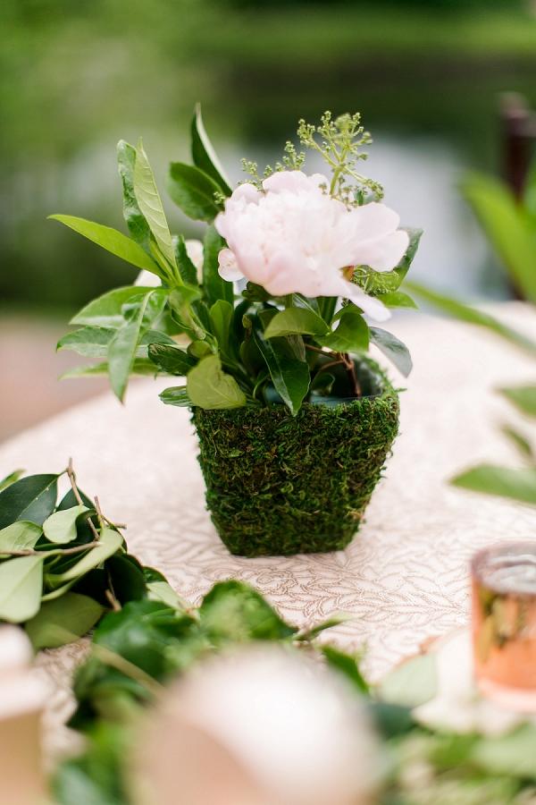 Moss covered centerpieces for garden wedding