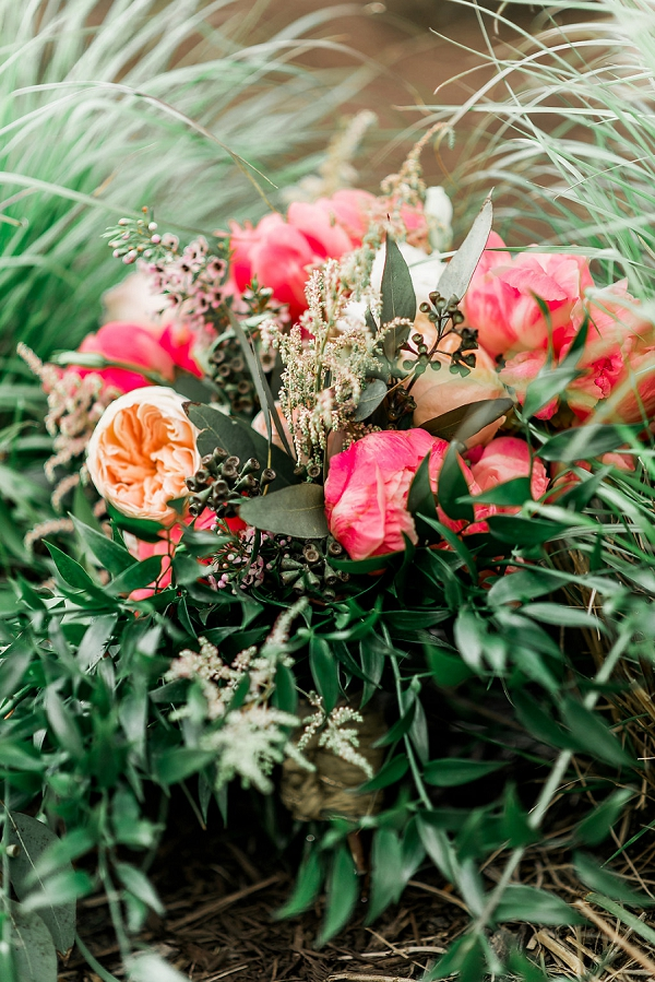 Rustic wedding bouquet with coral charm peonies and garden roses