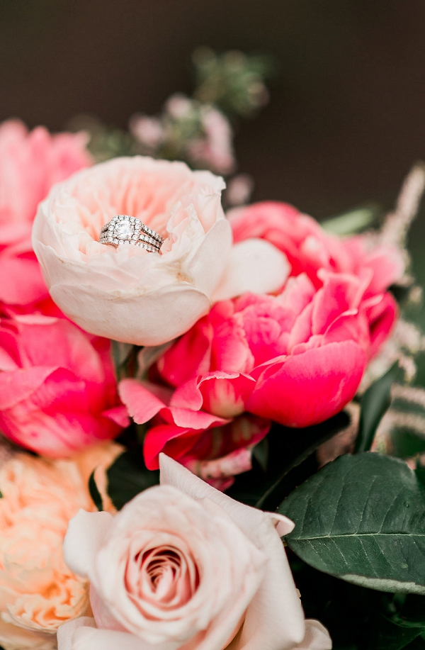 Gorgeous engagement ring shot with coral charm peonies and garden roses