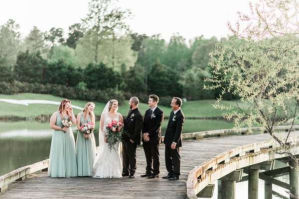 Sage green bridesmaid dresses and classic black suits for modern rustic wedding party