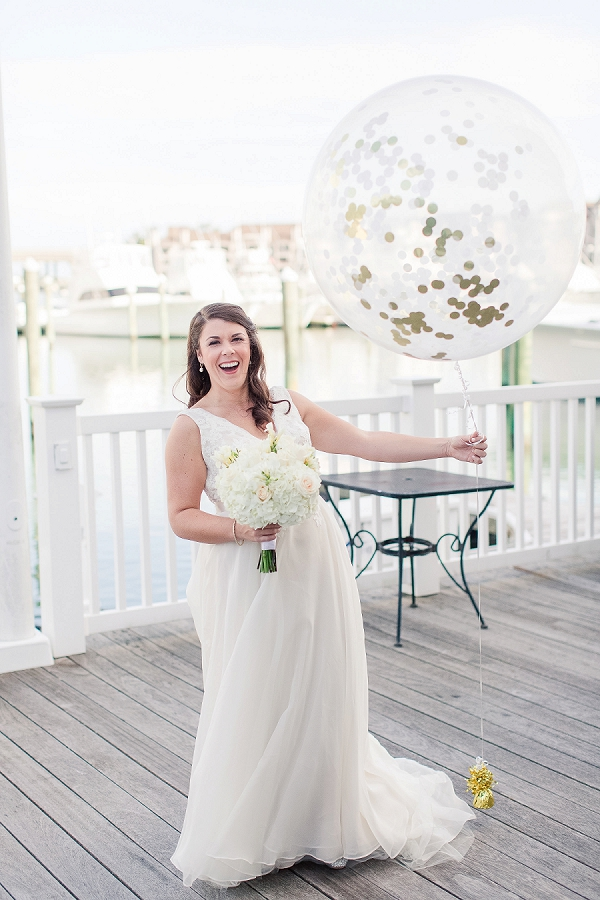 Bride with giant gold confetti filled balloon