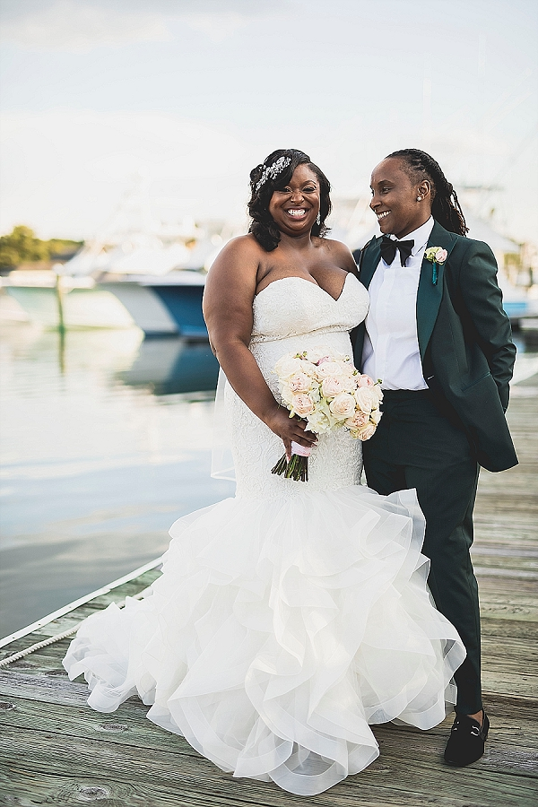 Two brides on the Water Table docks in Virginia Beach