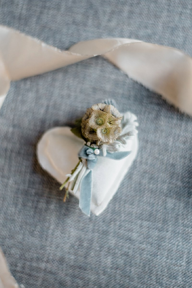 Small scabiosa wedding boutonniere with blue velvet ribbon for classic yacht club wedding