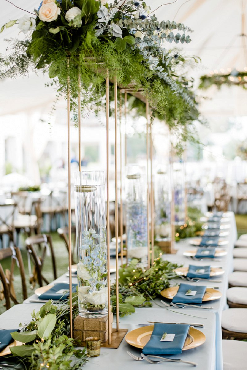Tall wedding greenery centerpieces with glass vases and gold stands for classic outdoor wedding
