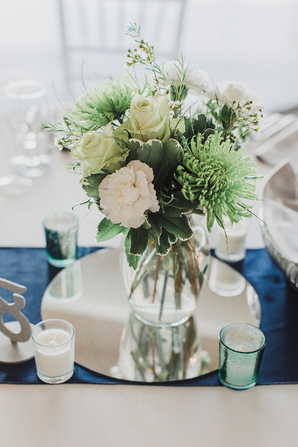 Green and white flowers for St Patricks Day wedding reception centerpiece