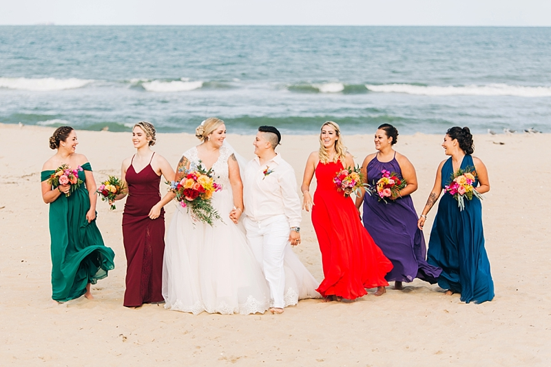 Jewel toned bridesmaid dresses for LGBTQ wedding on the beach
