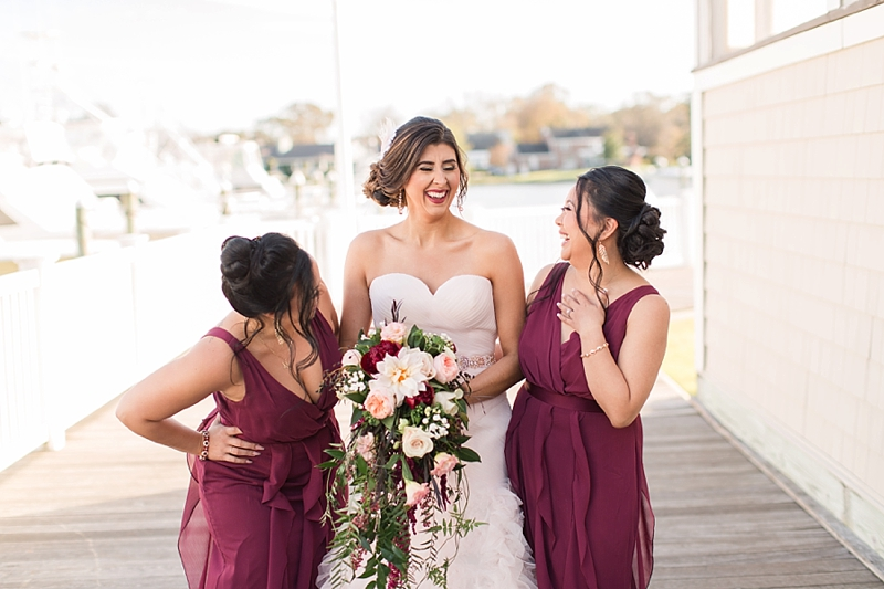 Happy bridesmaids and bride in ruffled dresses