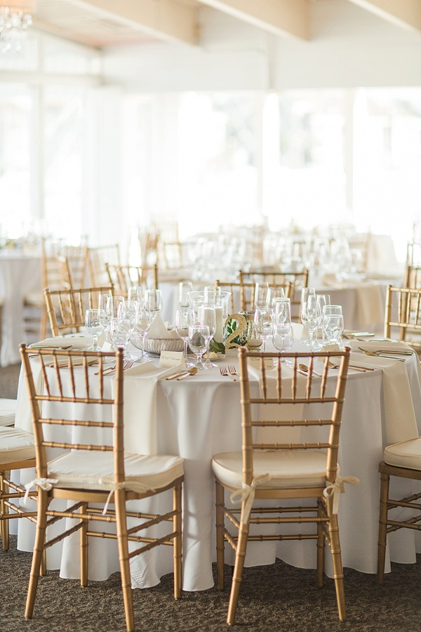 Gold and white wedding reception decor