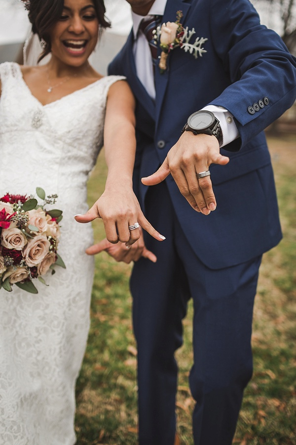 Bride and groom giving Hawaiian shaka hand gesture
