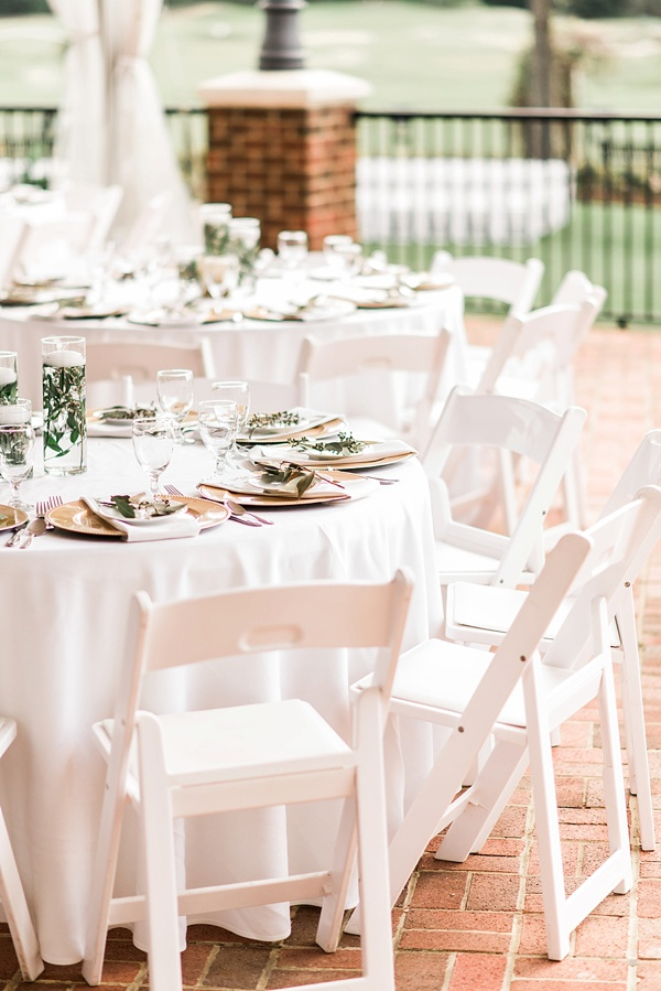 Simply chic outdoor wedding reception decor ideas with gold chargers and white chairs