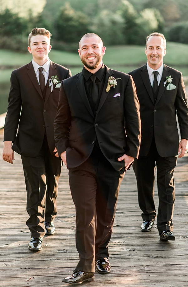 Groom in an all black wedding suit
