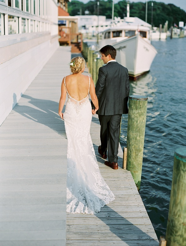 Romantic pier portraits for bride and groom at Lesner Inn in Virginia Beach