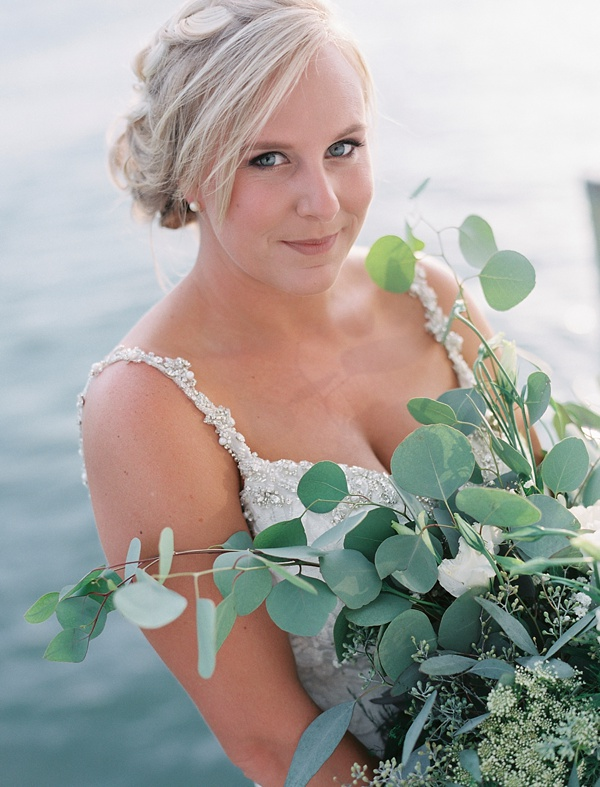 Relaxed braided bridal updo and natural makeup for a casual wedding