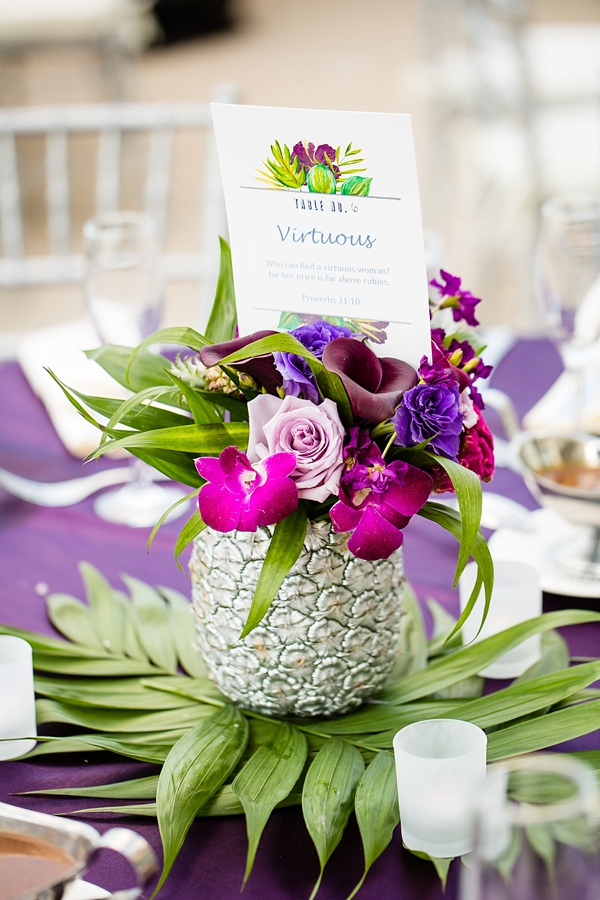 Bible verse inspired table number with silver pineapple and tropical purple flowers