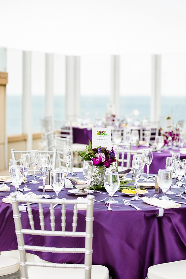 Tropical rooftop wedding with purple linens and silver chiavari chairs