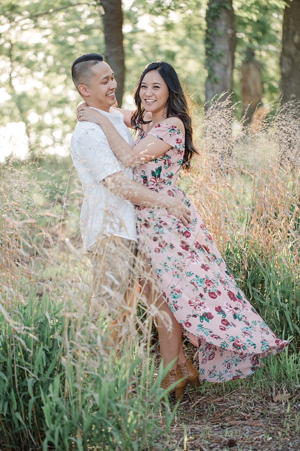 Stylish engagement session with off the shoulder jumpsuit and maxi skirt overlay