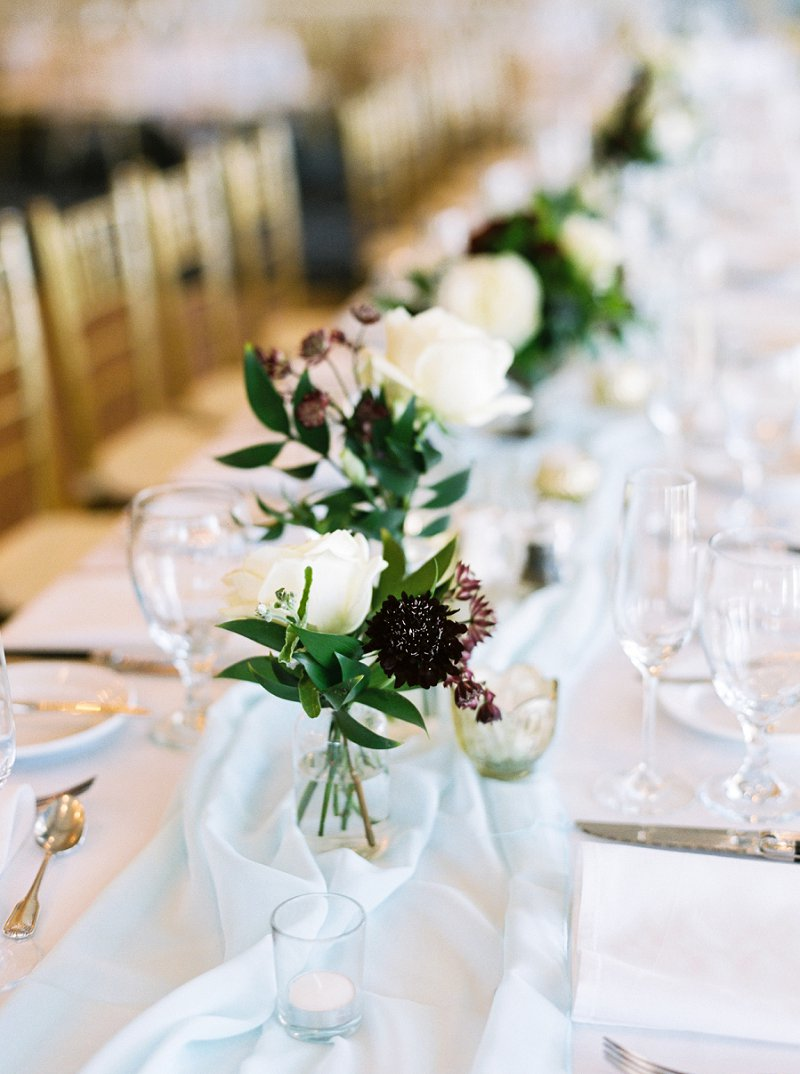 Simple and classic low centerpieces for elegant country club wedding
