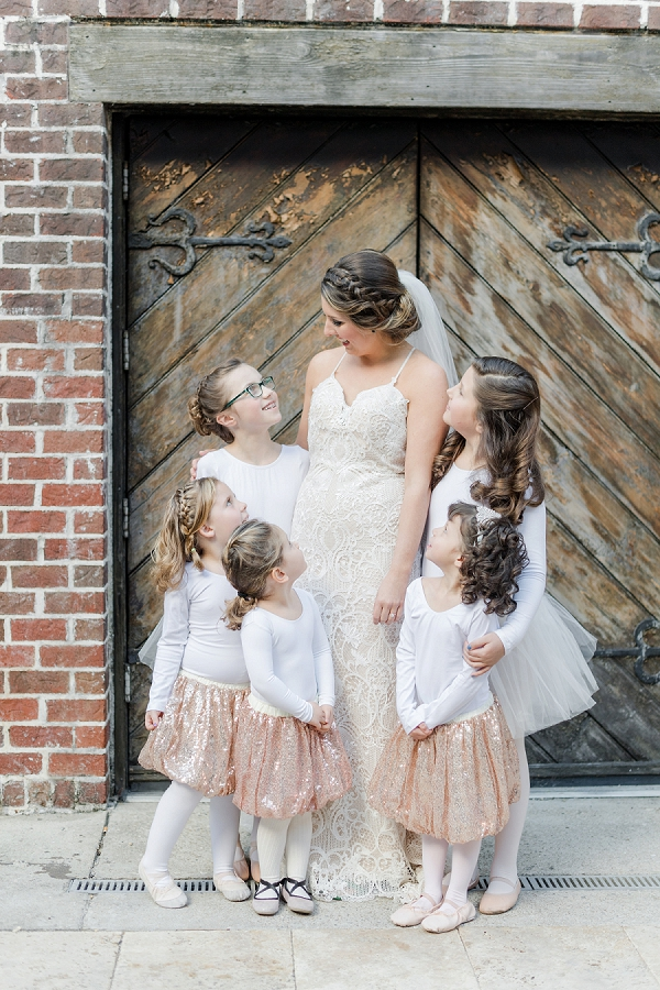 Bride and her flower girls in rose pink sequin tutus