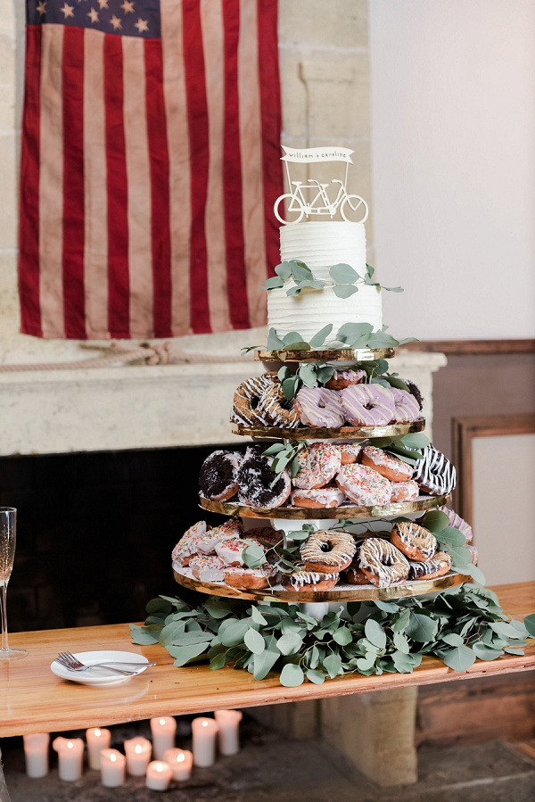 Gorgeous and delicious donut wedding cake with fun wooden bicycle cake topper