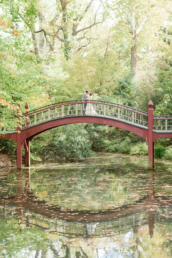 Bride and groom on Crim Dell Bridge at College of William and Mary