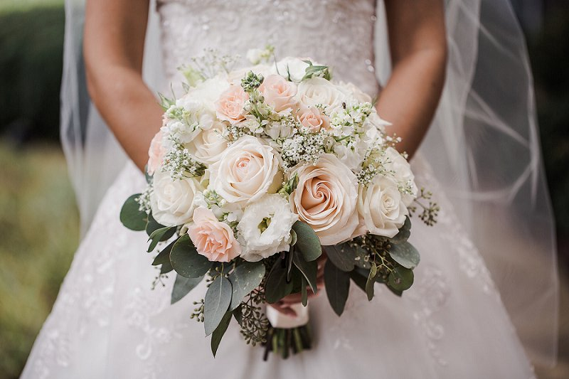 Classic bridal bouquet with roses and eucalyptus