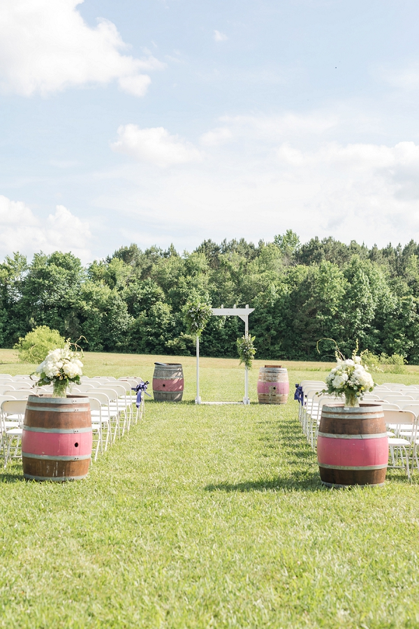 Coral pink wine barrels for fun and unique touch for winery wedding