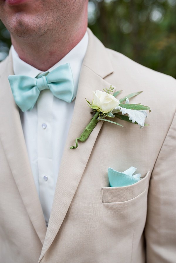 Mint green bow tie and sand colored suit