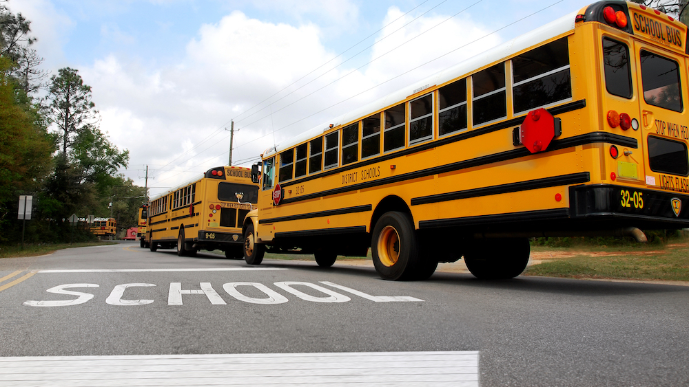 bigstock-School-buses-lined-up-at-schoo-25720904.jpg