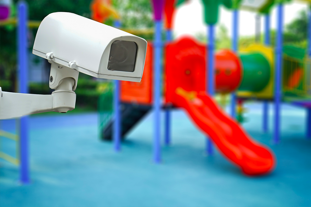 school playground with security camera