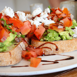 Avo Zen topped with tomato salsa, Greek fetta and balsamic