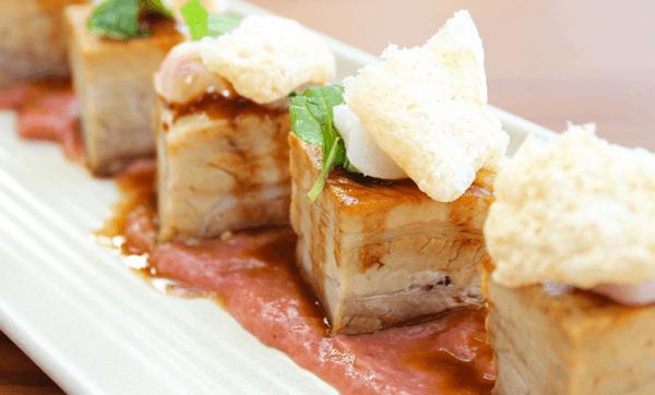 Fennel Sri Lankan chilli pork belly with lyche apple mint salad, rhubarb and pork bubbles