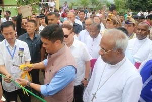 Cm-prema-kandu-cuts-ribbon-with-bishops-behind-medium