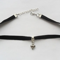 Black velvet ribbon adjustable choker with heart pendant and a width of  3/8""
