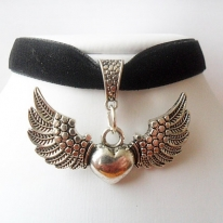 Black velvet ribbon adjustable choker with winged heart pendant and a width of 1/2""