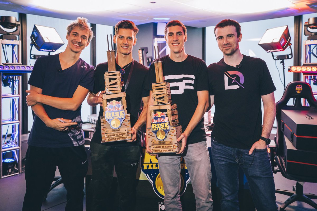 Ninja and DrLupo with the champions of the Red Bull Rise Till Dawn Fortnite Tournament. Players all of ages turned out for the chance to play against Ninja. (Source: Red Bull)