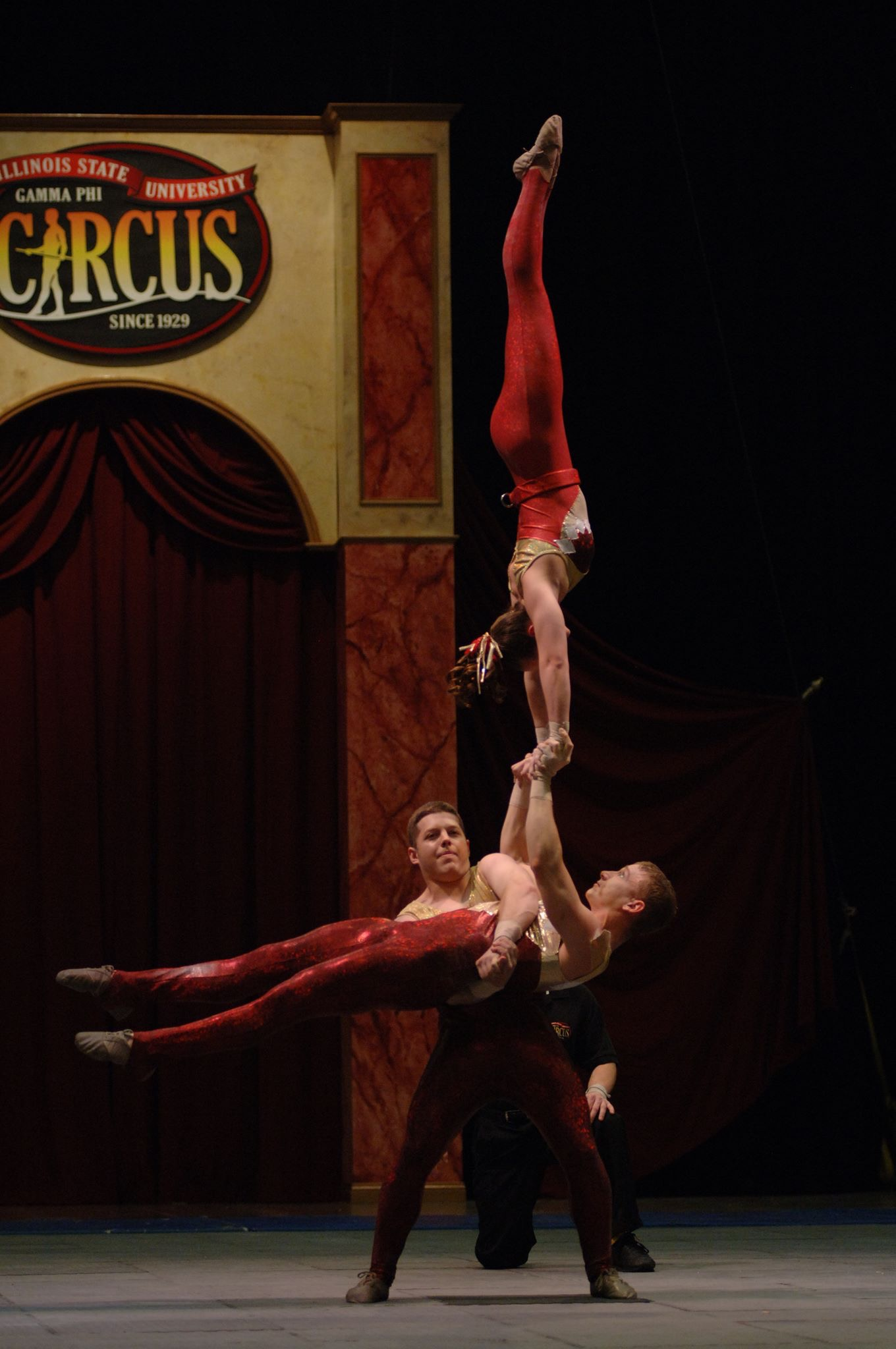 Rebecca Nemecek performing hand balancing in the Gamma Phi Circus at Illinois State University. Rebecca's husband is the base (holding her and the other performer).