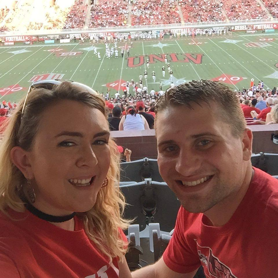 Lauren Bratland and her husband enjoying a UNLV football game.