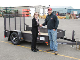Felling Trailers president/CEO, Brenda Jennissen, congratulates the winning bidder, Patrick Stepan.