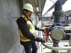 In this March 16, 2017, photo, Robert Waddle, division operations manager at the West Point Treatment Plant in Seattle, stands near a closed valve next to empty pools normally used to remove grit and other solids from sewage and storm water. An analysis released Friday, May 19, 2017, said equipment failures caused between $49 million and $57 million of damage at the state's largest sewage treatment plant. (Ted S. Warren / AP)