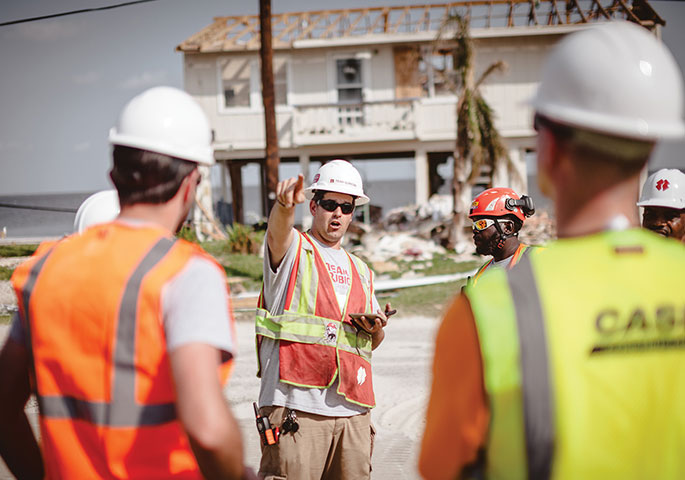 Photo by CASE Construction Equipment and Matt Mateiescu,Team Rubicon